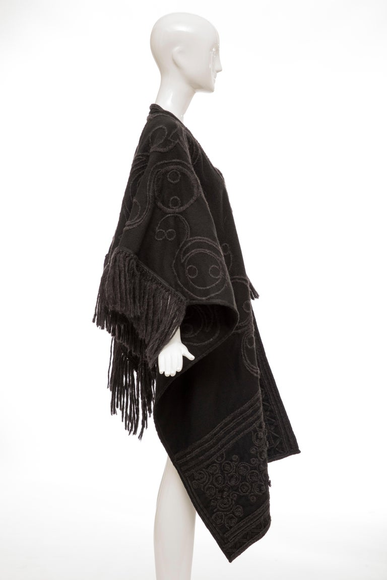 Dries Van Noten, Fall 2002  runway black wool embroidered cap with tie front and back fringe detail.  Length: 40