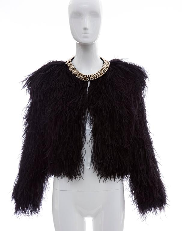 "Givenchy black ostrich feather jacket with gold-tone chain trim collar. open front and fully lined in silk.  Bust 36"", Waist 36"", Shoulder 17"",  Length 17""  EU. size 38  US. size 6"