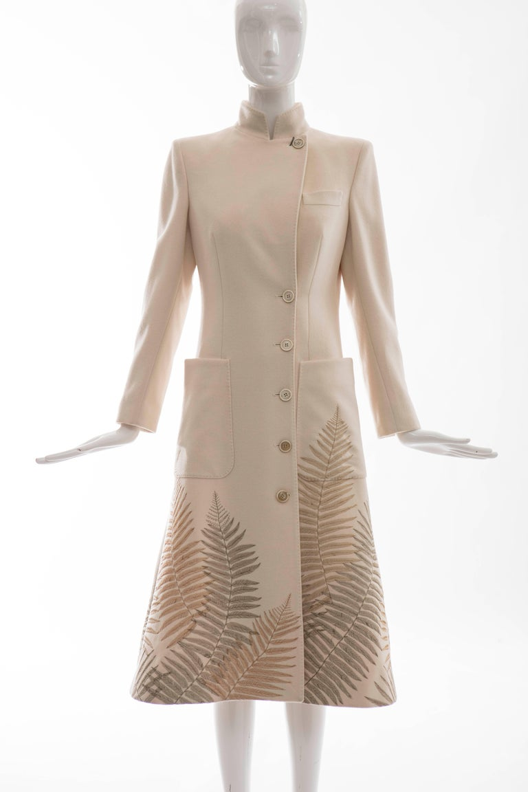 Alexander McQueen, Autumn-Winter 2007 cream cashmere coat with gold-tone fern embroidery, large patch pockets at waist, front button closures and fully lined.