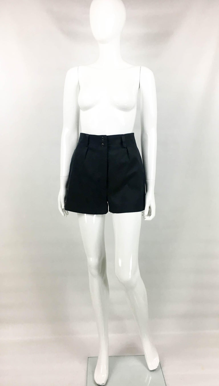 Vintage Alaia Black Cotton Shorts. These very cute shorts by Azzedine Alaia date back from the 1990's. Made in cotton blend, these tailored shorts have a high waist, side pockets and one pocket on the back. The fit is loose, and the silhouette is