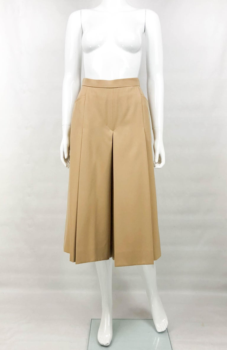 Vintage Hermes Beige Culottes. These very stylish culottes by Hermes date back from the 1970's. Made in beige wool and with side pockets, they hover just below the knees. The waist is high and the silhouette is lose, with a lot of movement. Lined in