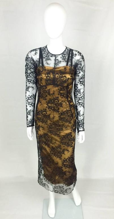 Gorgeous Dolce and Gabbana 2-Piece Dress. This sexy dress is made of two pieces: the underneath bronze sheath dress (fitted, body-hugging) and will accentuate the curves and give a great silhouette (lined); on top, the long sleeves black lace brings