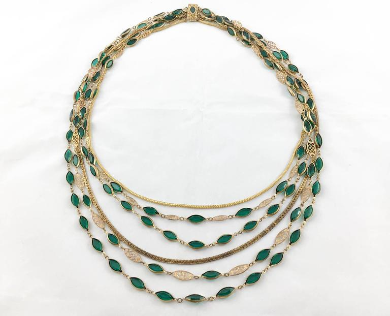 Striking Vintage Multi-Strand Necklace. This spectacular piece is made of 6 strings featuring green paste and gold-tone metal. This is a unique piece, probably from France and from the 1940s/1950s. It comprises different design aspects from the