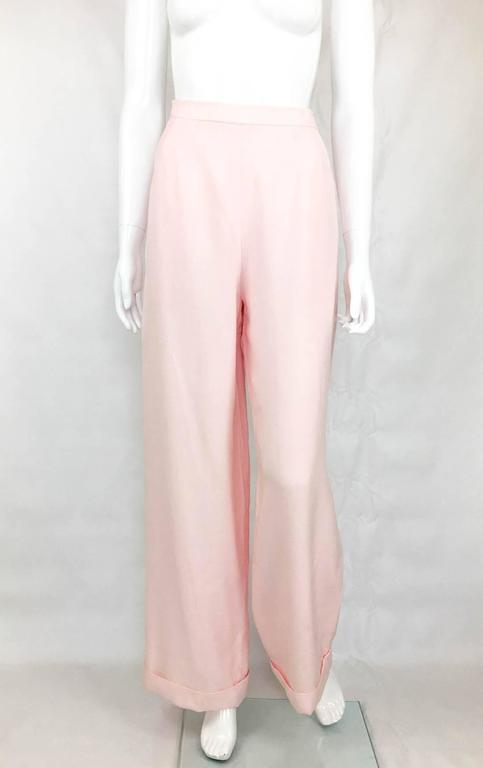 Vintage Chanel Pale Pink Linen Trousers. These gorgeous wide-legged trousers by Chanel from the 1990s are made in the finest of linens. It is fully lined in the same colour silk. High-waisted and with wide legs, these trousers are very stylish. Side