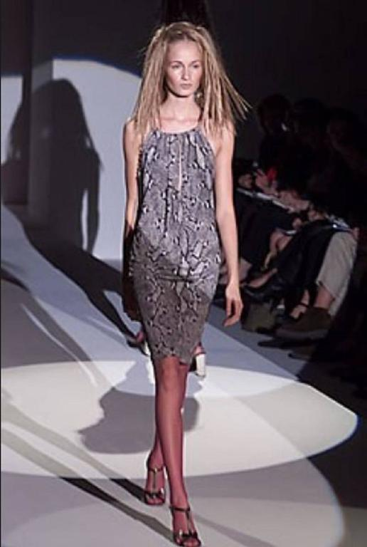 Gucci by Tom Ford Iconic Python Print Runway Dress. This gorgeous dress by Gucci was designed by Tom Ford and showed on the SS 2000 fashion show. The python print in shades of grey is Gucci signed. Self-lined. The dress features a delicate leather
