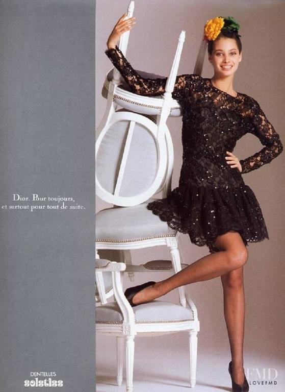 Amazing Vintage Dior Lace and Sequins Dress. This fabulous dress was worn by the iconic Christy Turlington in the Dior Fall Campaign in 1987. In gorgeous black lace, it features ornaments in black sequins, as well as black flowers constructed out of