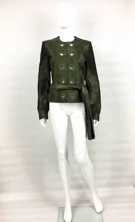 Gorgeous Yves Saint Laurent Moss Green Ponyskin Jacket. This fabulous unworn jacket by Saint Laurent is made of the best quality ponyskin / calf hair in moss green. It features brass eyelets down the front. The closure is done by hooks, which are