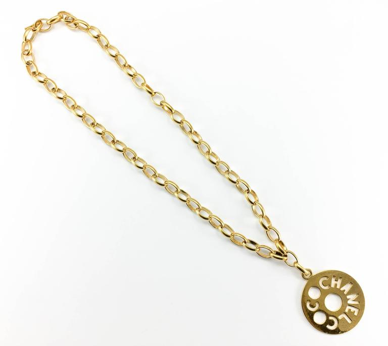 Women's Chanel Chunky Gold-Tone 'Coco Chanel' Disk Pendant Chain Necklace - 1970's For Sale