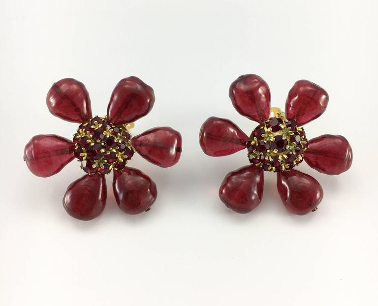 Stunning Vintage Chanel Red Gripoix Flower Clip-On Earrings. These amazing earrings by Chanel date back from the 1970's. They are shaped as large stylised flowers. The petals are made in deep, burnt red gripoix (poured glass), whereas the centre