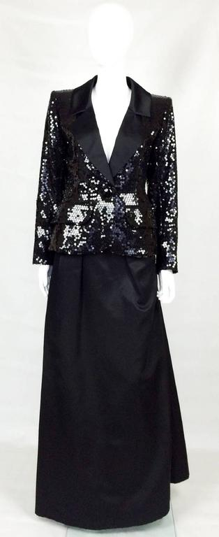 Spectacular Rare Vintage Yves Saint Laurent Le Smoking Sequin Evening Ensemble. This fabulous black Yves Saint Le Smoking ensemble comprises a sequin jacket, a floor-length skirt and a pencil skirt. The sequin jacket is truly stunning and current.