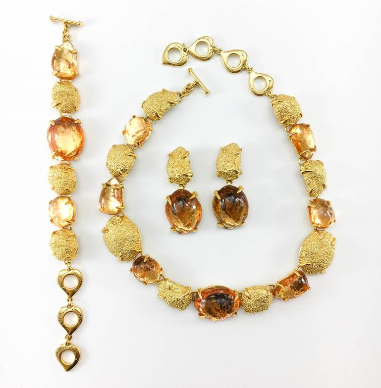 Vintage Yves Saint Laurent Necklace, Bracelet and Earrings Set. This fabulous set by Yves Saint Laurent was created by Robert Goossens in the 1980's. As it was a trademark in Goossens' work, the pieces have a very organic look and feel. The design