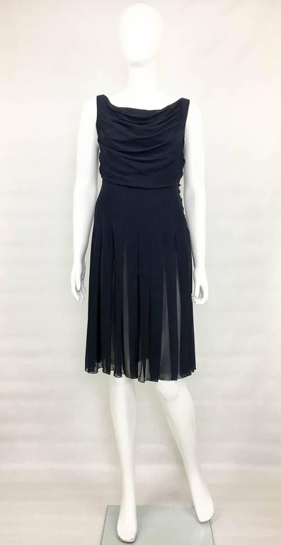Vintage Chanel Midnight Blue Silk Chiffon Dress. This chic sleeveless dress by Chanel is part of the 2000 Spring / Summer Collection. In midnight blue silk chiffon, it has a draped bust and pleats to the skirt. It is self-lined and it has an