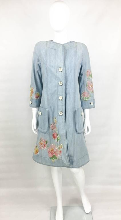 Dior Runway Look Denim Shirt Dress. This striking shirt dress by Dior was created by John Galliano for the 2005 Spring / Summer Runway Show (please refer to photos for a shot of a model wearing an identical dress on the runway). Made in denim, this