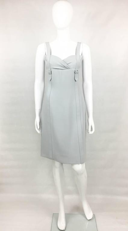 Valentino Pale Blue Silk Dress. This elegant dress by Valentino is made, and lined, in pure silk. Knee-length, it features belt-style straps and draping to the bust. It closes with an invisible zipper on the back. A chic and versatile dress that can