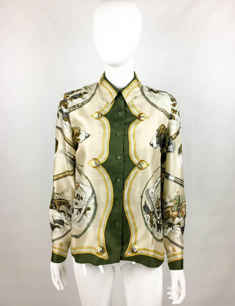 Vintage Hermes Printed Silk Shirt. This beautiful silk shirt by Hermes dates back from the 1970's, more precisely from 1979. The hunting-themed print, designed by J. de Fangerolla, features hounds and hunters on horses, as well as medallions with