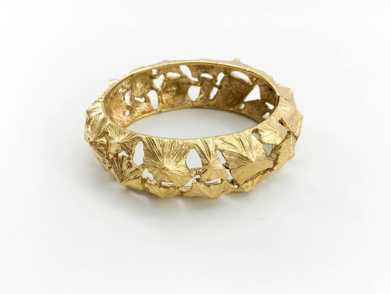Dazzling Vintage Lanvin Bracelet. This super stylish Lanvin bracelet in gilt metal has a fabulous design. This statement piece is Lanvin signed on the inside. This is a great example of designer costume jewellery that will add a bit of flare to any