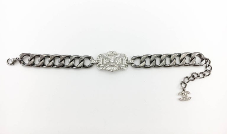 Chanel Rhinestone Embellished Grey Chain Choker Necklace. This beautiful choker necklace by Chanel was designed for the 2014 Resort Collection Runway Show. Karl Lagerfeld used this piece several times on the runway, by itself or paired with another