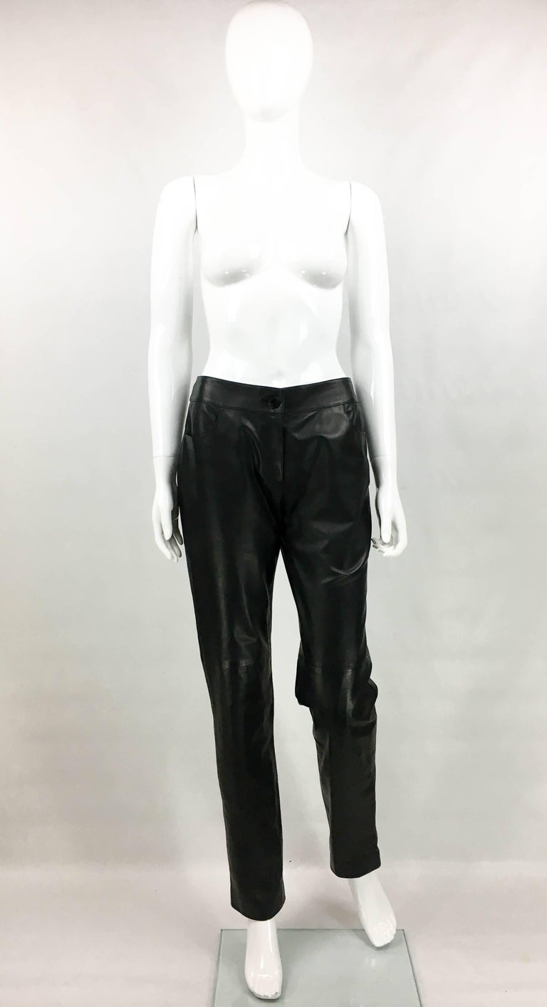 Vintage Chanel Runway Look Black Leather Trousers. This gorgeous leather pants by Chanel was created for the 2003 Fall / Winter collection. Made in black calfskin leather, it features a straight cut design with 2 front pockets and 2 back pockets.