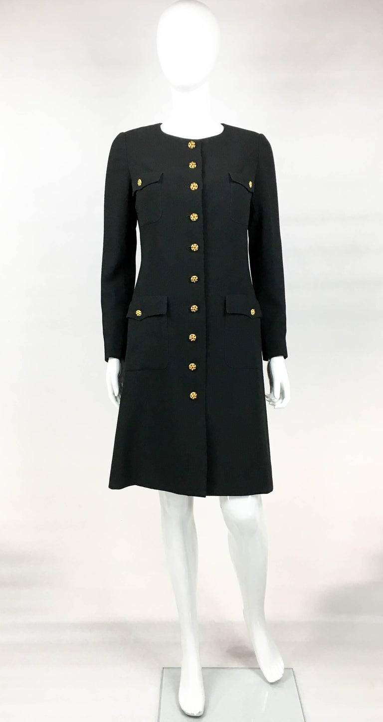 Vintage Chanel Runway Look Black Wool Coat/Dress With Baroque-esque Buttons. This gorgeous piece by Chanel was designed for the 1996 Autumn / Winter Collection and the runway show (refer to photos). Made in light black wool and lined in black silk,