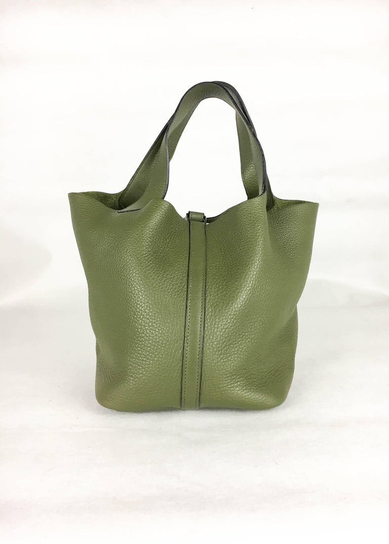 Gorgeous Hermes Picotin Handbag. In olive green clemence leather and palladium hardware, this is a very stylish handbag by Hermes. Green suede on the inside. Hermes signed, date code 'K' in a square (2007). An understated piece of luxury by the