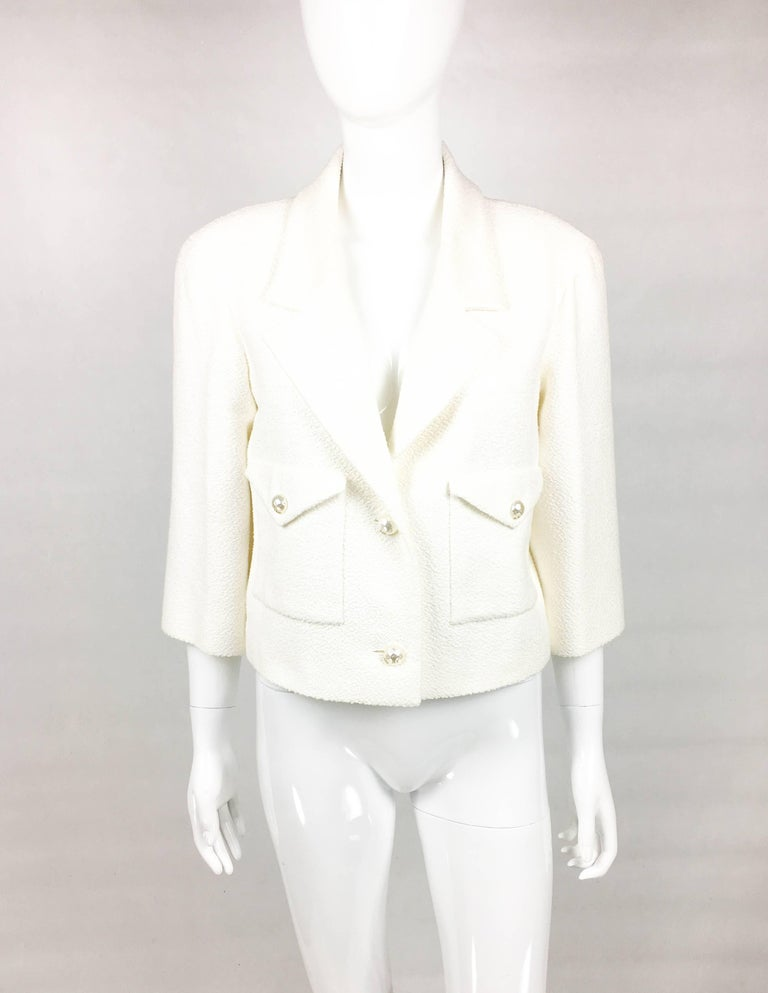 Chanel White Cotton-Blend Jacket With Faux-Pearl Buttons. This beautiful jacket was created for the Chanel 2012 Spring / Summer Collection. An identical design can be seen on a model on the runway show (please refer to photos). Made in a texturized