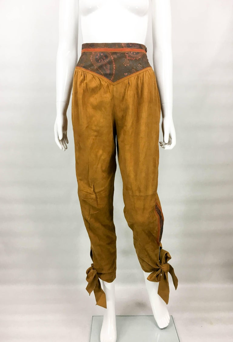 Vintage Roberto Cavalli Brown Suede Cropped Trousers. These very stylish trousers by Roberto Cavalli date back from the 1980's. High-waisted, they are made in camel suede and feature painted leather panels on the waist and down the sides. A striking