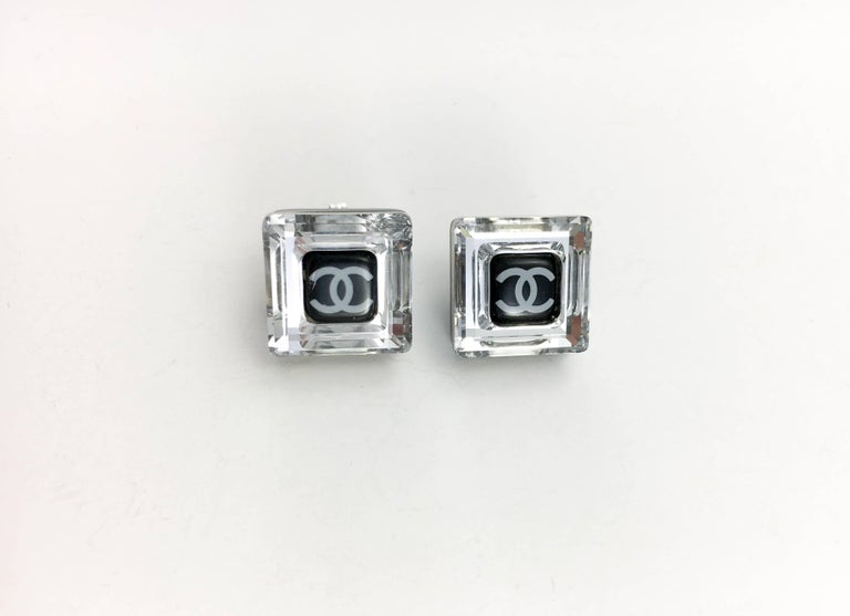 Chanel Square Logo Post Earrings. These beautiful earrings by Chanel were created for the 2005 Autumn / Winter Collection. Made in clear and black resin, these delicate square-shaped earrings feature the iconic 'CC' logo in the centre. Chanel marked