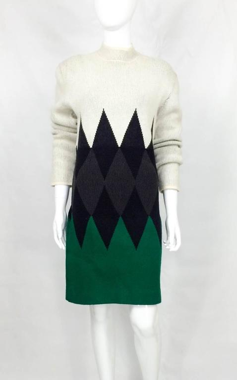 Sleek Vintage Jean Paul Gaultier Wool Dress. This is a stylish long-sleeve dress in beige, black, grey and green with a mock turtle neck. The area with the grey lozenges is slightly cinched in, giving it a little bit of structure and creating a