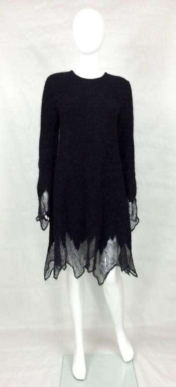 Fabulous Chanel black mohair sweater dress. This fantastic Chanel fall 2009 runway look piece has a simple pull-over design with one sparkly black button showing the Chanel logo at the back of the neck. Made of soft black mohair blend, it features