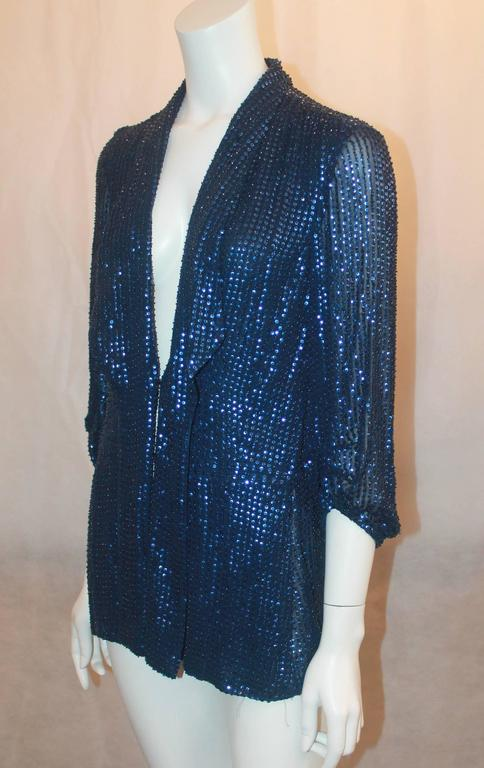 Diane Von Furstenberg Blue Sequin Loose Blouse - 6. This blouse is in very good condition and is a unique, gorgeous piece. The main tag is gone and there is a small hole in the fabric by the left shoulder. It features cinched sleeves, pleats along
