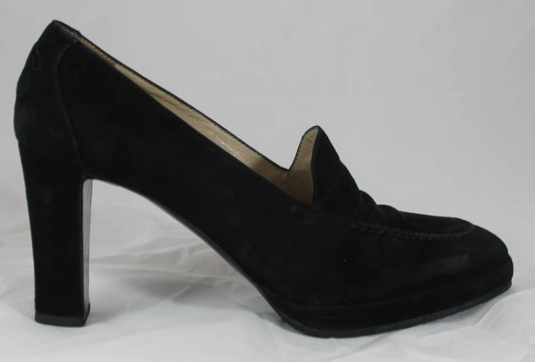 Chanel Black Suede Loafer Style Pumps - 36.5. These loafers are black suede with a vintage feel to them. They are in good condition with some discoloration on the suede.
