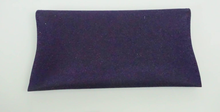 VBH Purple Sparkle Manila Clutch This beautiful clutch is in excellent condition, comes with the box and retailed for $1,150. The clutch has a beautiful purple sparkle color and is lined in purple suede. It has stitching detail on the outside and 3