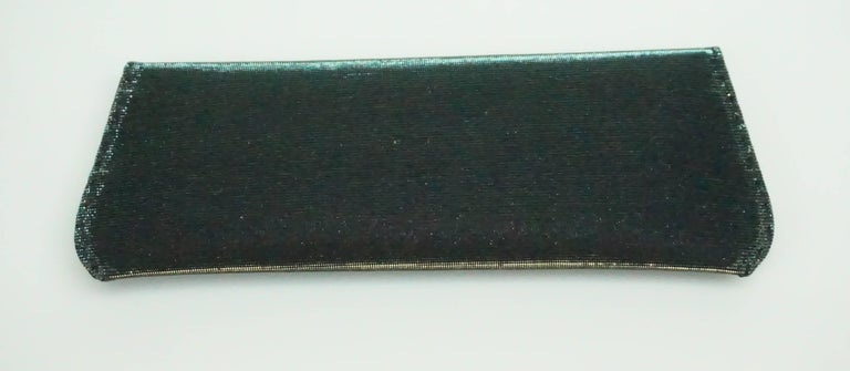 VBH Dark Green Iridescent Manila Clutch  This spectacular clutch has shimmer in a beautiful forrest green color. The clutch comes with the box and retailed for $1,150. It is lined in suede and has one main compartment and one small interior pocket.