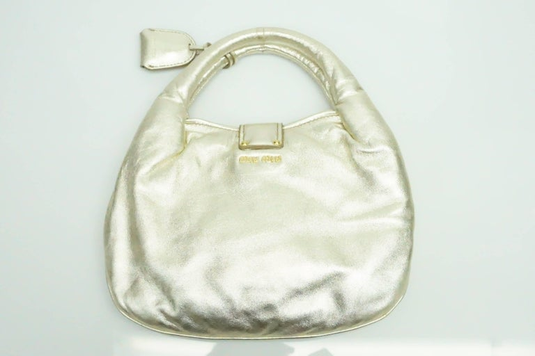 Miu Gold Puffy Soft Leather Handbag This Unique Metallic With Hardware