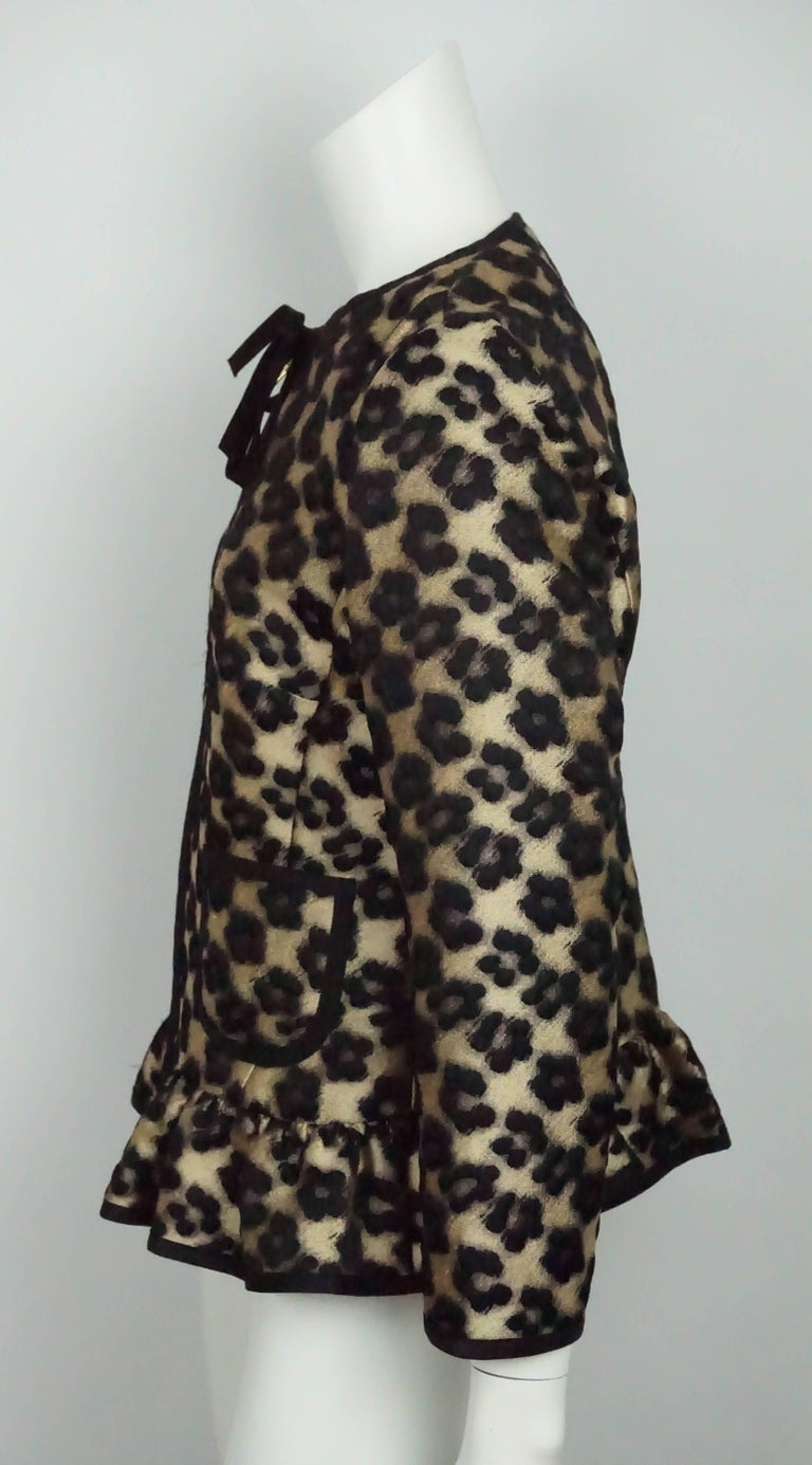 Red Valentino Gold and Black Leopard Print Silk Jacket - 8   This gorgeous leopard print jacket is in excellent condition. The jacket is a wool/ polyester blend and has no lining. There is a ribbon detail around the neckline that goes down the