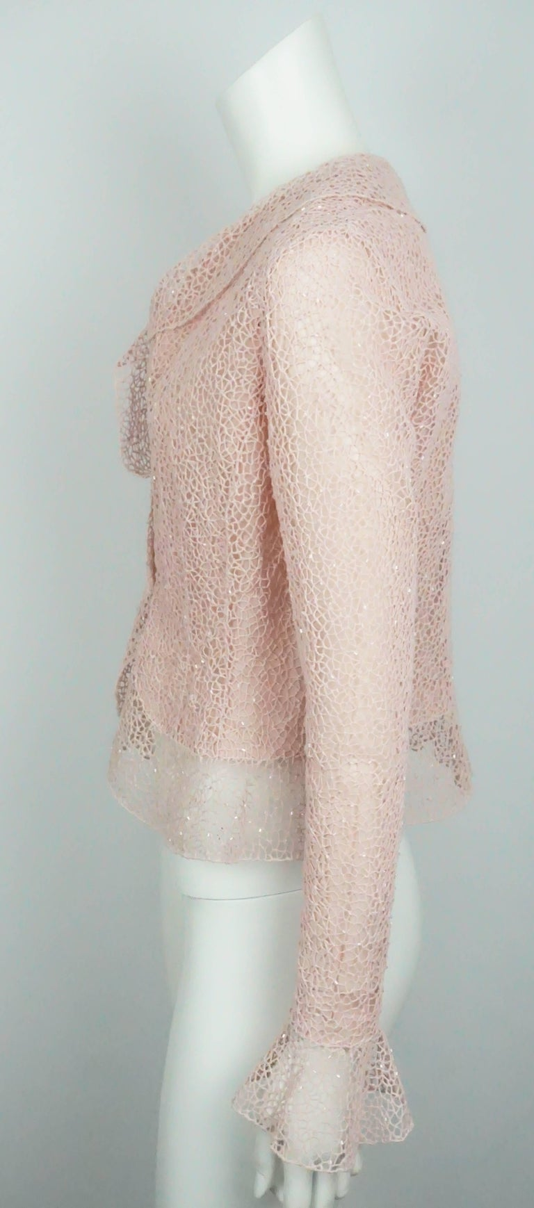 Oscar De La Renta Pink Crochet Lace Sequin Jacket - 8  This beautiful cotton jacket is in good condition. There are minor stains around the wrist and in one of the armpits of the jacket. It is lined in silk organza and there are two jewels that