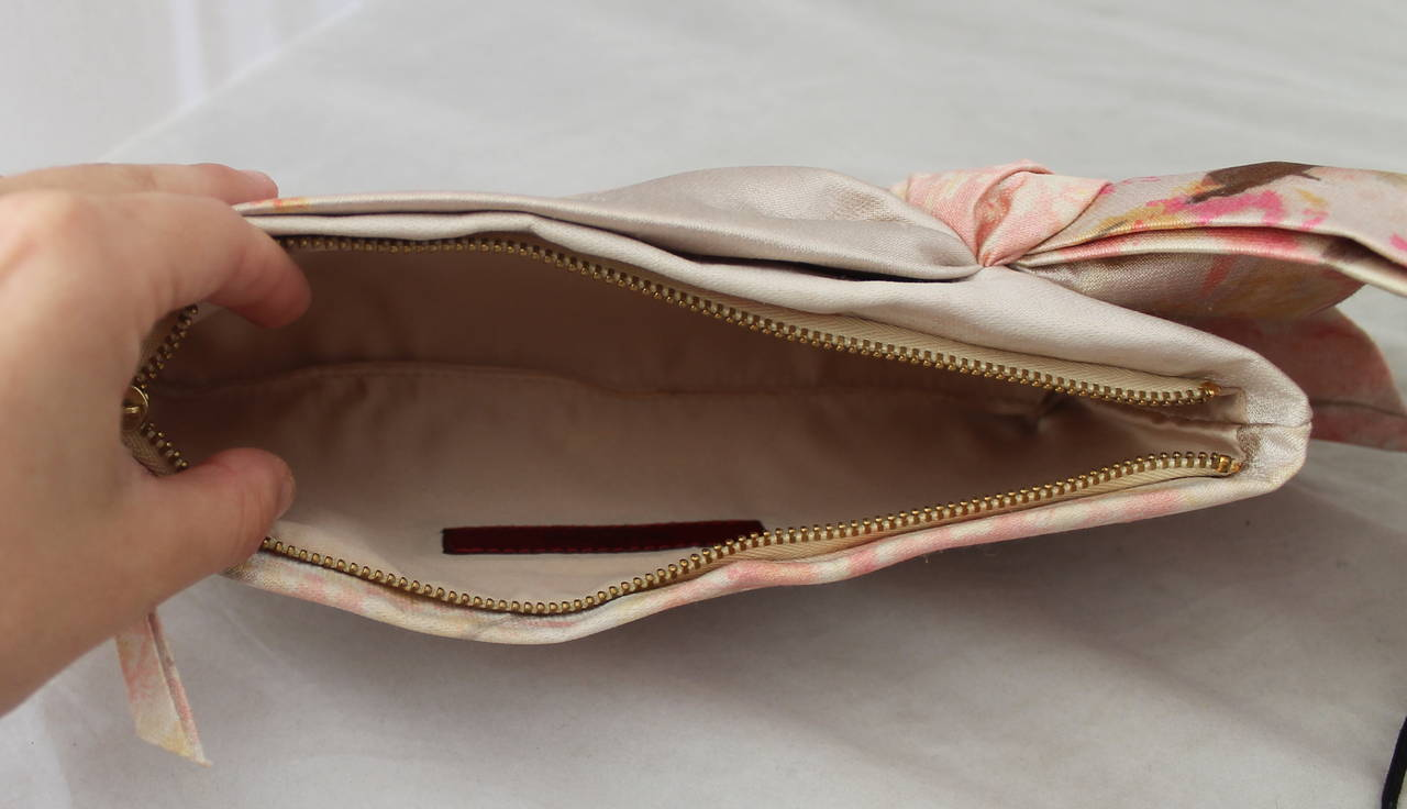 Valentino Tan & Pastel Pink Printed Bow Clutch In Excellent Condition For Sale In Palm Beach, FL