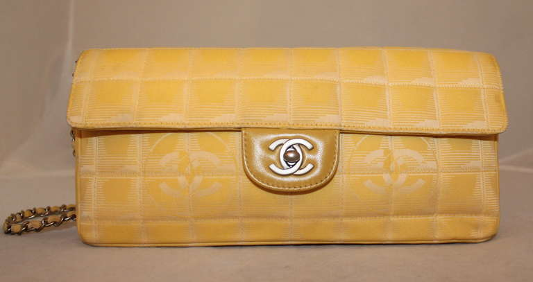 Chanel Yellow Nylon Single Flap Handbag- Circa 2002 - SHW This bag is in good condition. Slight Wear to the fabric and some marks on the interior. Handbag comes with Duster.  Measurements:  Width 10.5