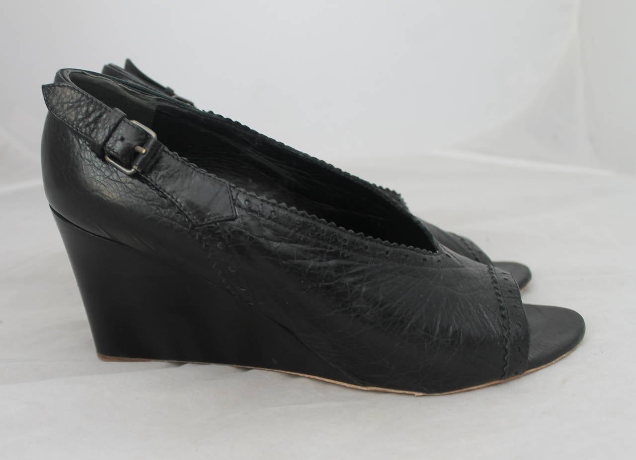 Balenciaga Black Leather Bootie Wedges - 41.5. These shoes are in very good condition with minimal wear on the leather and wear on the sole.