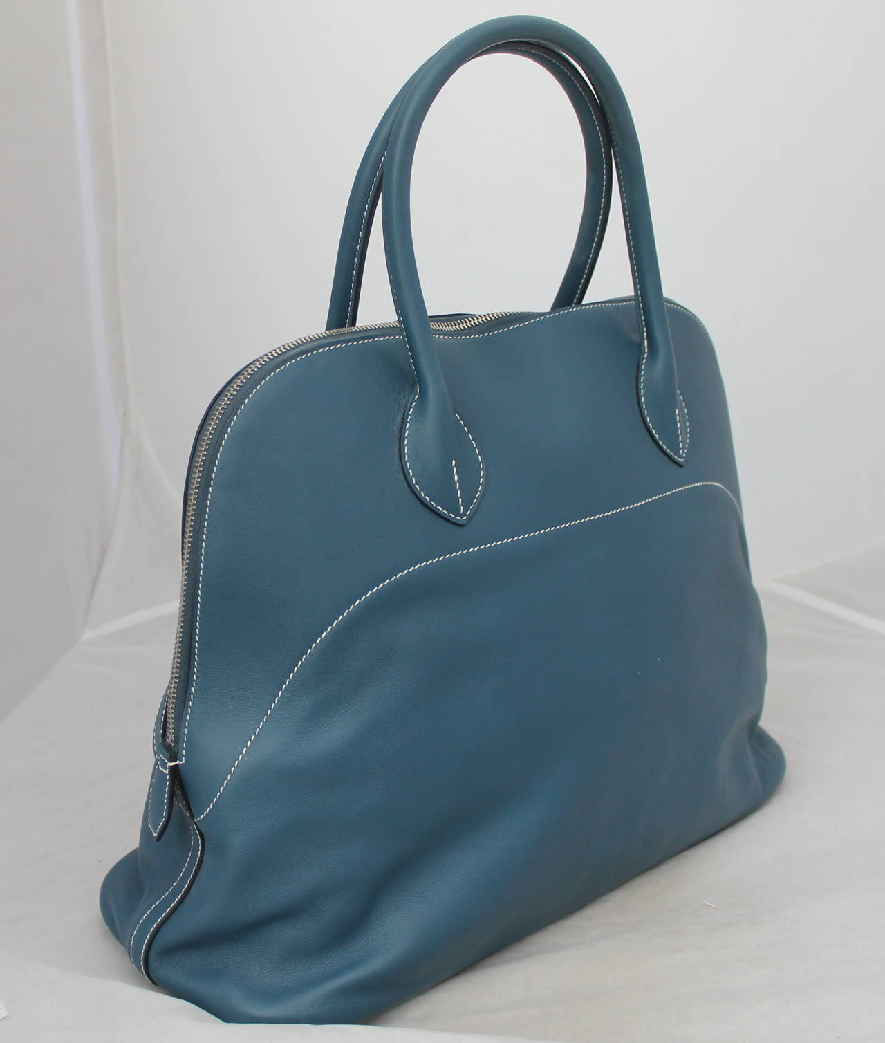 """Hermes Thalassa Blue 40cm Veau Swift Bolide Handbag circa 2012. This handbag is in very good condition with very light wear. It comes with a box, duster, lock, and lock duster.    Measurements: Length- 12"""" Width- 16"""" Depth- 6"""" Handle Drop- 5"""""""