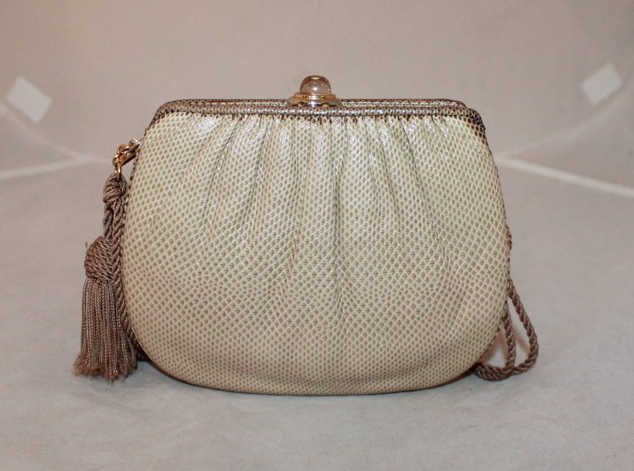 1990s Vintage Judith Leiber Two Tone Taupe Karung Handbag with Rope Handle. Can also be used as a clutch. Bag comes with coin purse and compact mirror and is in very good condition.