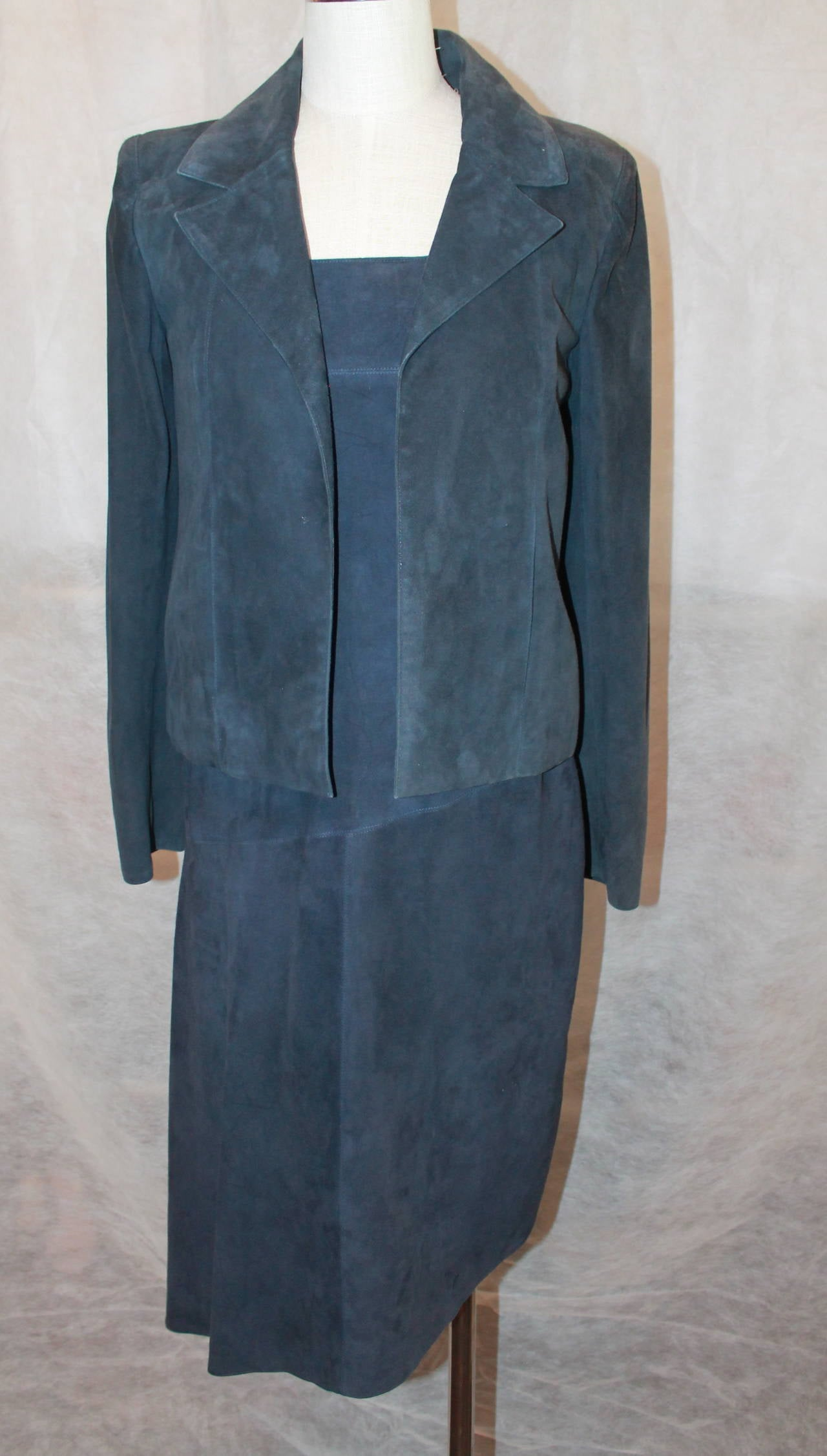 2002 Chanel Navy Suede Two Piece Dress and Jacket. Dress is Marked a Size 38 and Jacket is Marked a Size 36. Dress is Sleeveless with an Asymmetrical Hem and Jacket is a Blazer Style with no Buttons and Two Front Side Pockets.  Jacket