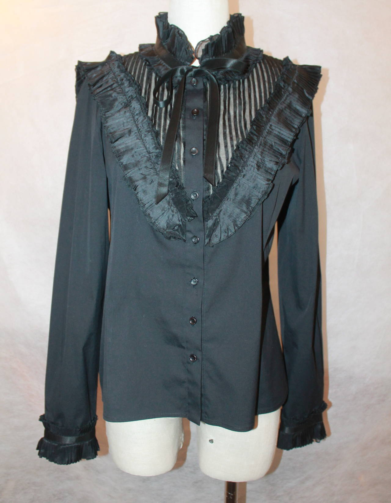 Oscar de la Renta Black Peasant Style Top with Pleating - M. This top is in very good condition with very minor fraying due to use along the neck detail. The cuffs also have a pleated design. 