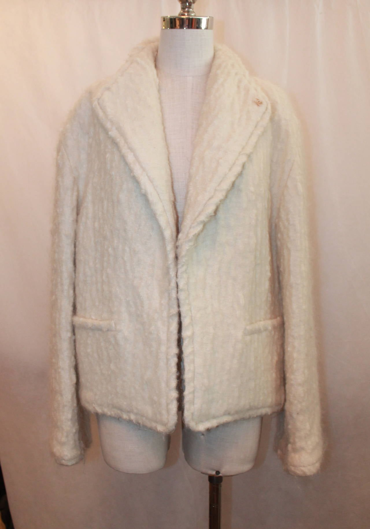 "Chanel 1998 Vintage Creme Mohair & Wool Blend Jacket - 38. This jacket is in excellent condition with minor signs of wear on the fabric. It has 2 front pockets and a mother of pearl ""CC"" emblem as seen on image 3. It also has silk lining."