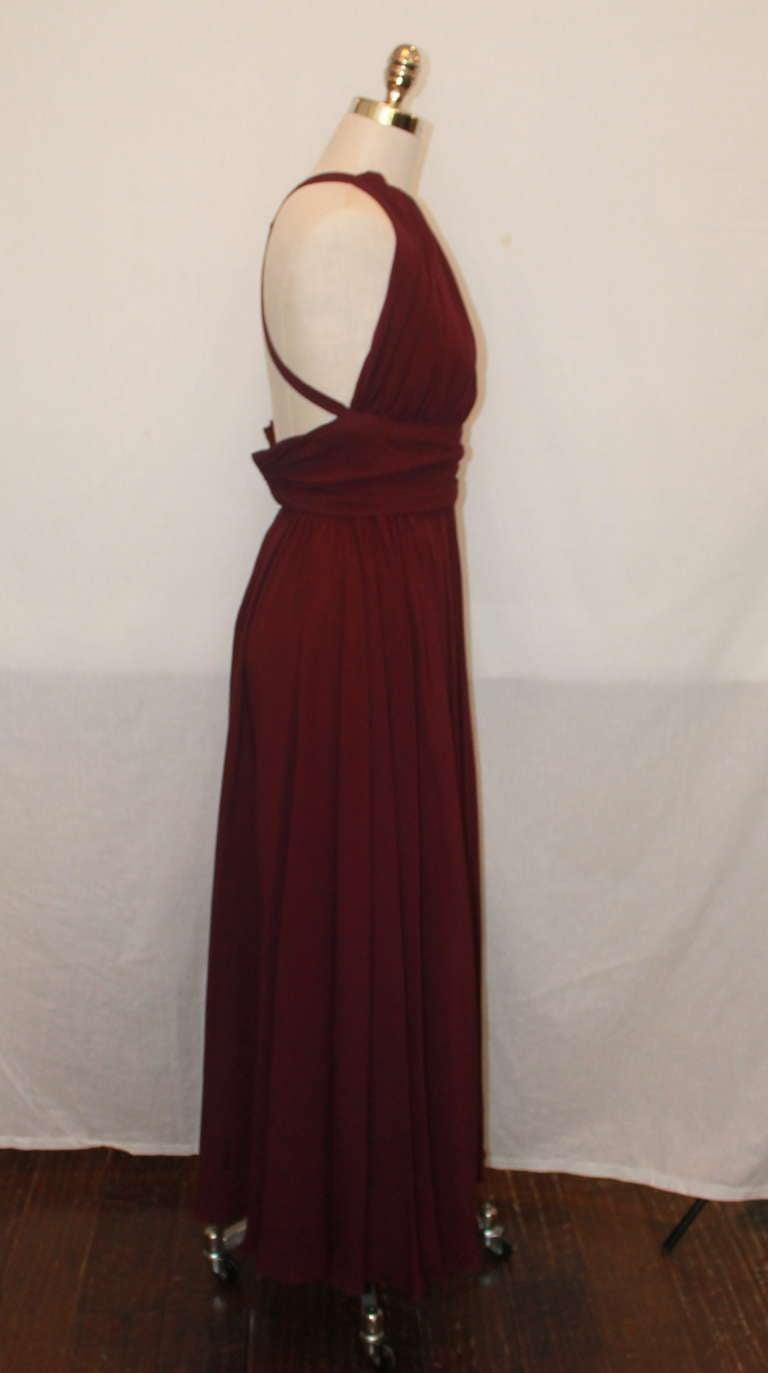 Carolyn Roehm matte jersey eggplant halter gown. This gown has subtle ruching and a crossed back. It is in excellent condition.
