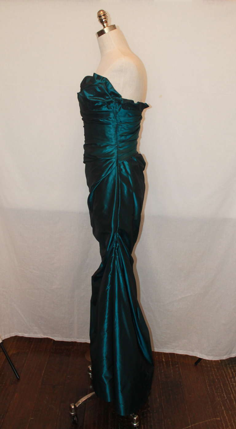 """Reem Acra rouched mermaid style silk taffeta gown. This is a strapless gown with a ruffled sweetheart neckline. The gown is in excellent condition and a size 6.  Measurements: Bust- 36"""" Waist- 28"""" Hips- 38"""" Length- 52"""" (Top of bust to hemn)"""