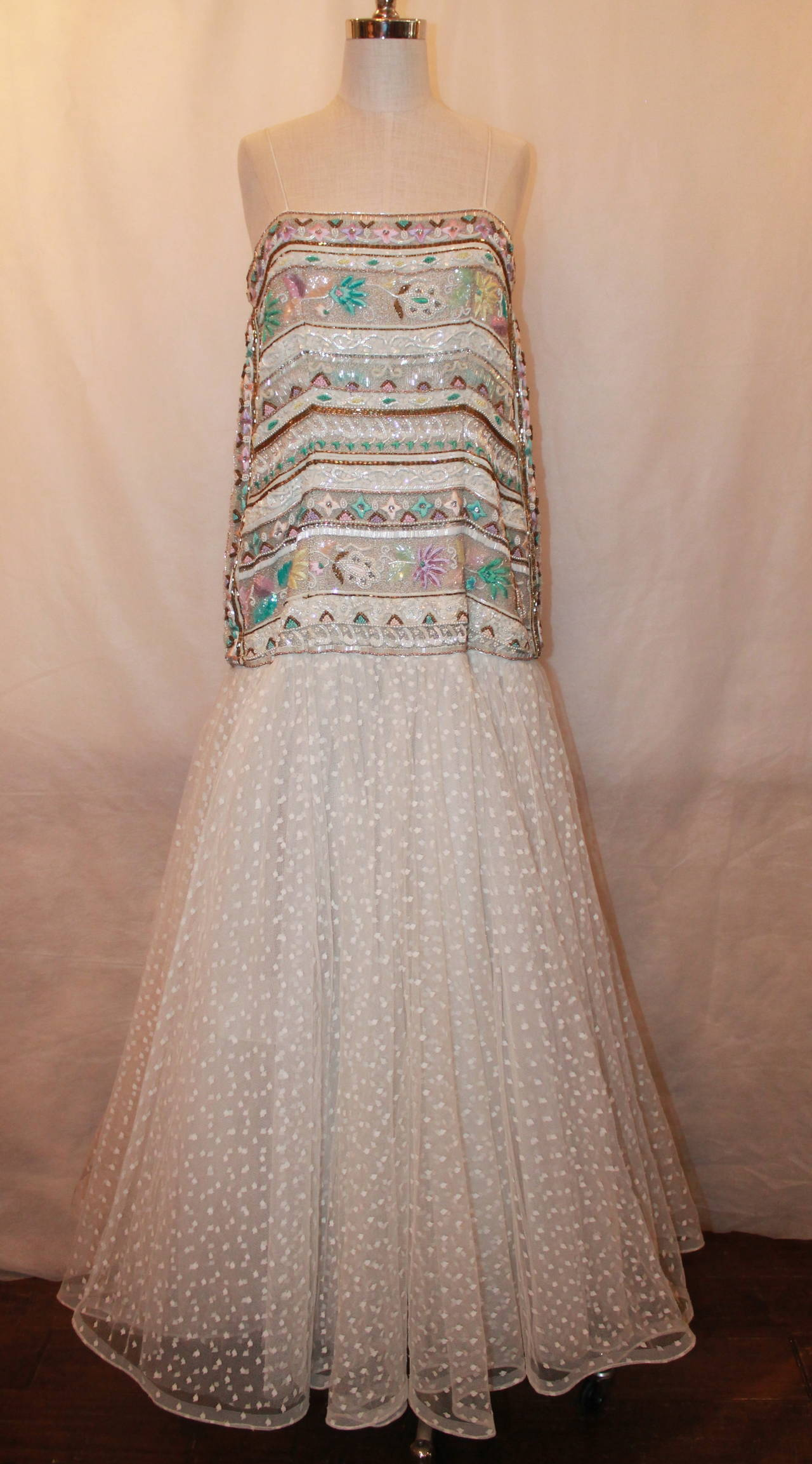 Richilene 1980's Vintage White Embroidered & Beaded Gown - 12. This gown is in good vintage condition with light wear consistent with age. A few beads are beginning to come undone. The beads and embroidery is multi-colored and floral. The skirt