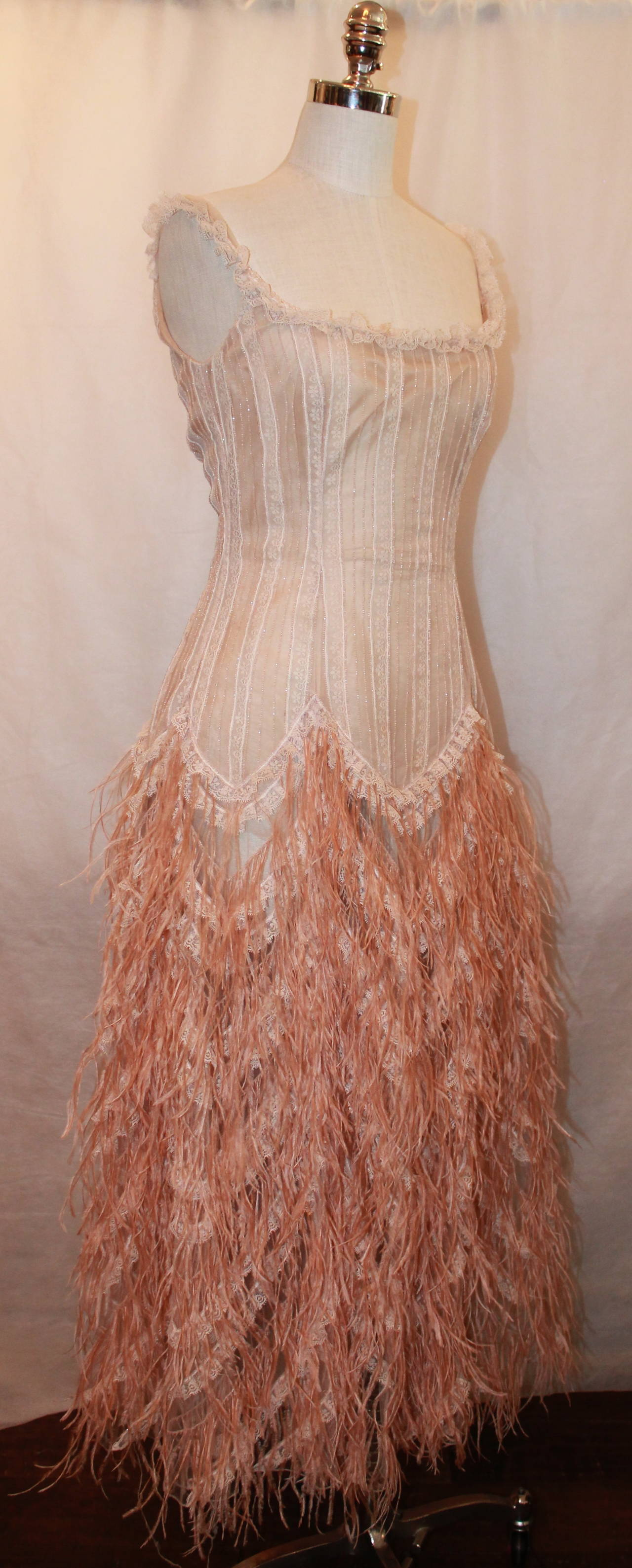 Oscar de la Renta Blush Lace Beaded Gown with Ostrich Feathers - M. This gown is in good condition with the only issue being on the bottom of the skirt (images 7-9). The bottom of the skirt has a rip on the side/back on the right side, but it is not