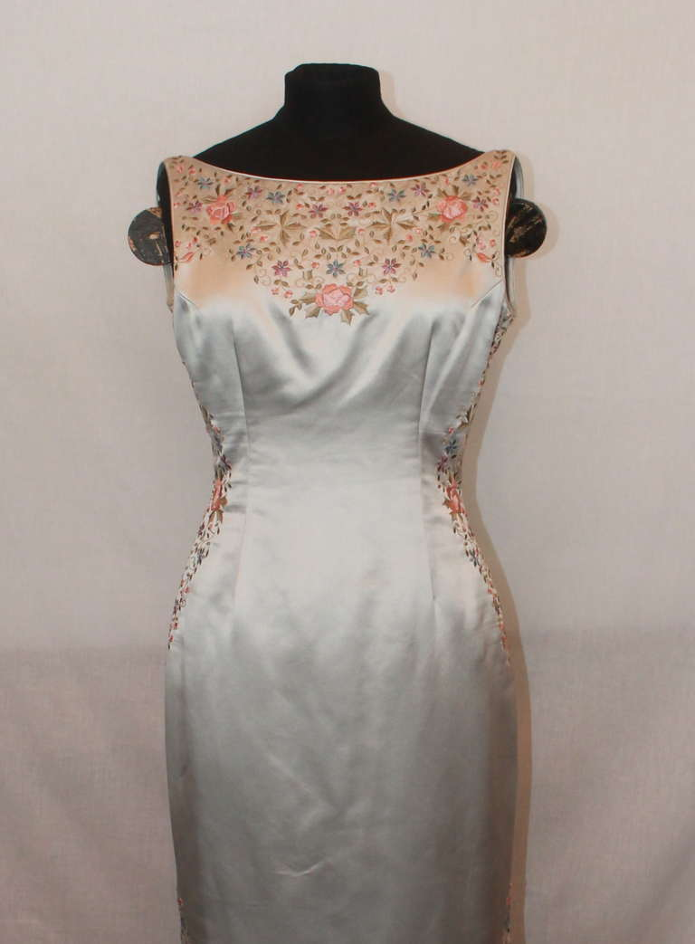 """Unknown Grey Silk Flower Embroidered Gown. This gown has slits on the side and is in excellent condition. Size 6. Measurements: Bust- 34"""" Waist- 27"""" Hips- 36.5"""" Length- 55"""" (neckline to hemn)"""
