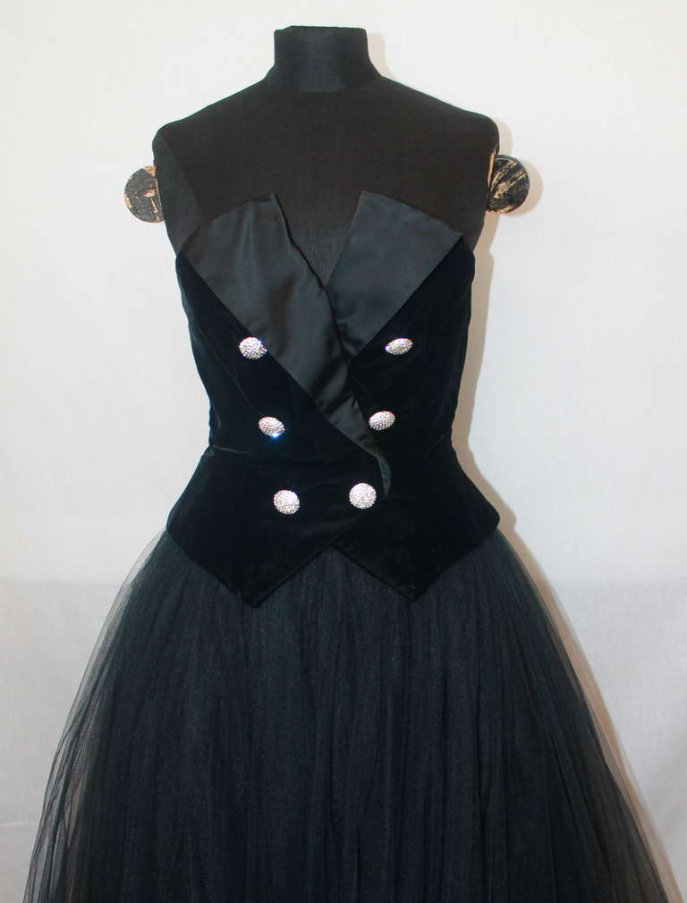 Belville Sassoon Vintage Black Tuxedo Style Gown. The bodice is velvet with a satin lapel and rhinestone buttons. The skirt is made of tulle. This gown is in excellent condition and a size 6. 